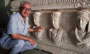A 2002 picture of Khaled al-Asaad in front of a rare sarcophagus from Palmyra depicting two priests dating from the first century. Photograph: Marc Deville/Gamma-Rapho via Getty Images (theguardian.com)